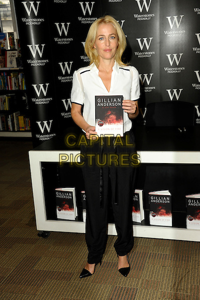 LONDON, ENGLAND - OCTOBER 03: Gillian Anderson meets fans and signs copies of her first novel 'Vision Of Fire' at Waterstone's, Piccadilly on October 3, 2014 in London, England.<br /> CAP/CJ<br /> &copy;Chris Joseph/Capital Pictures