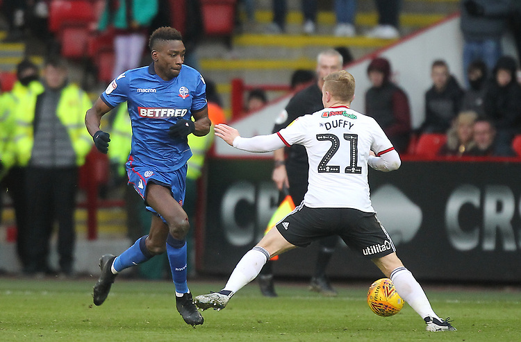 Bolton Wanderers Sammy Ameobi in action with Sheffield United's Mark Duffy<br /> <br /> Photographer Mick Walker/CameraSport<br /> <br /> The EFL Sky Bet Championship - Sheffield United v Bolton Wanderers - Saturday 2nd February 2019 - Bramall Lane - Sheffield<br /> <br /> World Copyright © 2019 CameraSport. All rights reserved. 43 Linden Ave. Countesthorpe. Leicester. England. LE8 5PG - Tel: +44 (0) 116 277 4147 - admin@camerasport.com - www.camerasport.com