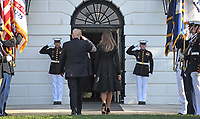 United States President Donald J. Trump salutes the Marine Guards as he and first lady Melania Trump return to the White House after leading a moment of silence in remembrance of those lost on September 11, 2001 on the South Lawn of the White House in Washington, DC on Monday, September 11, 2017.<br /> CAP/MPI/CNP/RS<br /> &copy;RS/CNP/MPI/Capital Pictures