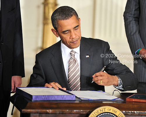 United States President Barack Obama signs the Manufacturing Enhancement Act of 2010, a bill that will help create jobs and invest in the manufacturing sector of the U.S. economy in the East Room of the White House in Washington, D.C. on Wednesday, August 11, 2010..Credit: Ron Sachs / CNP