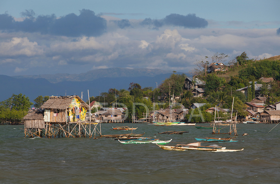 Stilt houses sit above the water near Bias City, Negros, Philippines.