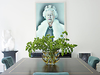 A holographic portrait of Queen Elizabeth II by Chris Levine dominates the dining room