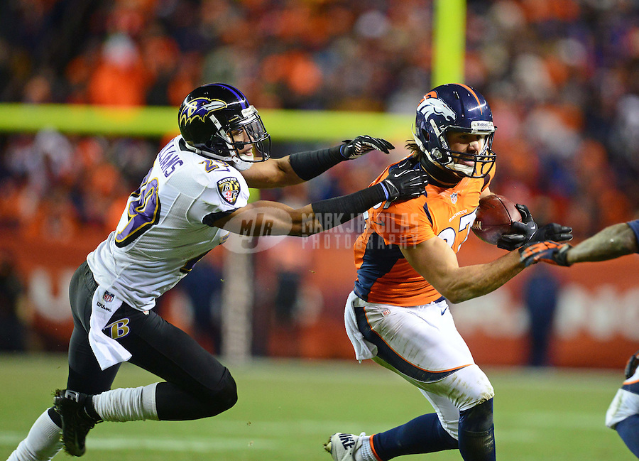 Jan 12, 2013; Denver, CO, USA; Baltimore Ravens cornerback Cary Williams (29) tackles Denver Broncos wide receiver Eric Decker (87) during the AFC divisional round playoff game at Sports Authority Field.  Mandatory Credit: Mark J. Rebilas-