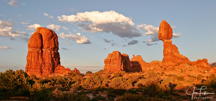 Sunset light accentuates the color of the orange sandstone of Balanced Rock in Arches National Park, near Moab, Utah.