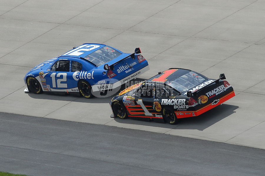 Jun 4, 2007; Dover, DE, USA; Nascar Nextel Cup Series driver Ryan Newman (12) leads Martin Truex Jr (1) during the Autism Speaks 400 at Dover International Speedway. Mandatory Credit: Mark J. Rebilas-US PRESSWIRE Copyright © 2007 Mark J. Rebilas..