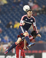 New England Revolution substitute forward Blake Brettschneider (23) heads the ball. In a Major League Soccer (MLS) match, the New England Revolution defeated Chicago Fire, 2-0, at Gillette Stadium on June 2, 2012.