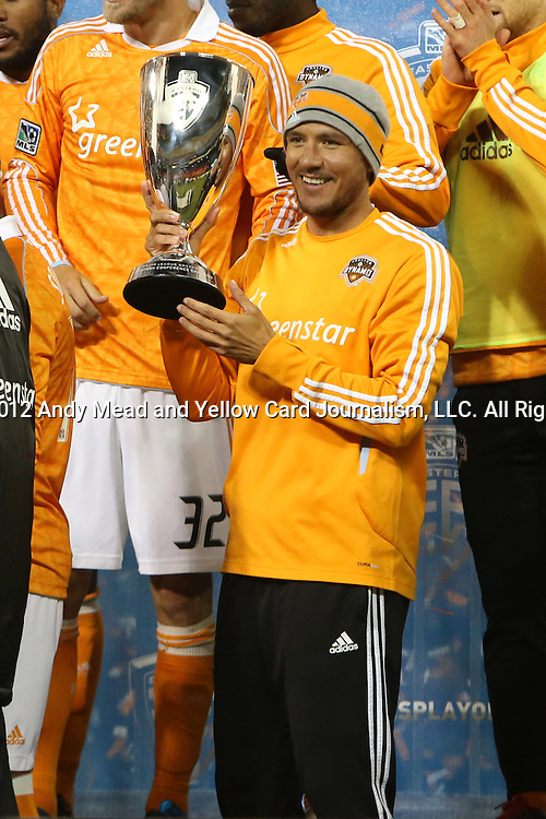 18 November 2012: Houston's Brian Ching poses with the Eastern Conference Trophy. DC United played the Houston Dynamo at RFK Stadium in Washington, DC in the second leg of their 2012 MLS Cup Playoffs Eastern Conference Final series. The game ended in a 1-1 tie, Houston won the series 4-2 on aggregate goals.