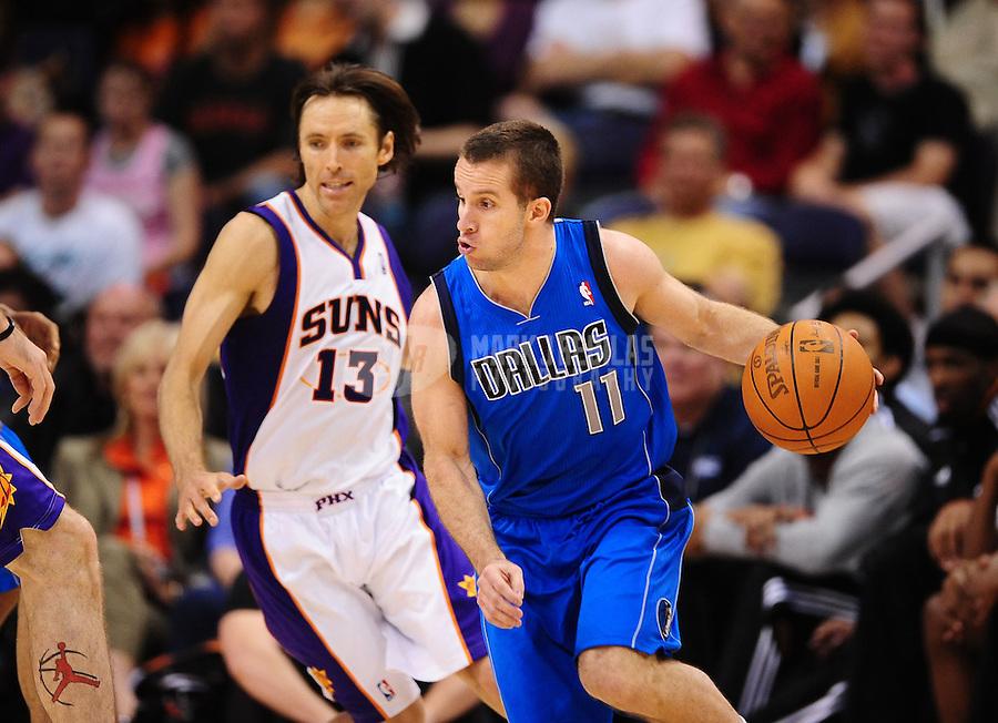 Mar. 27, 2011; Phoenix, AZ, USA; Dallas Mavericks guard (11) Jose Barea against Phoenix Suns guard (13) Steve Nash at the US Airways Center. Mandatory Credit: Mark J. Rebilas-