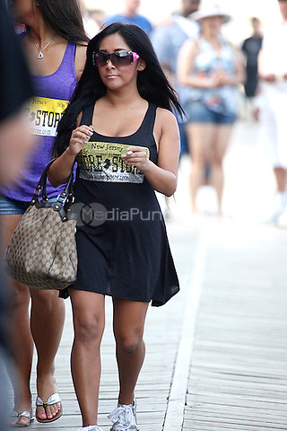 Snooki catching a smoke on the boardwalk before work at the Tee Shirt Store in Seaside Heights, NJ on July 5, 2011  © Star Shooter / MediaPunchInc