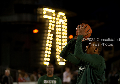 Michigan State University basketball player Derrick Nix shoots during a practice Thursday, November 10, 2011 in the basketball arena on the flight deck aboard Nimitz-class aircraft carrier USS Carl Vinson (CVN 70) in San Diego, California. Carl Vinson is hosting Michigan State University and the University of North Carolina for the inaugural Quicken Loans Carrier Classic basketball game on Veteran's Day, November 11.  United States President Barack Obama and first lady Michelle Obama are scheduled to attend the game..Mandatory Credit: James R. Evans - U.S. Navy via CNP