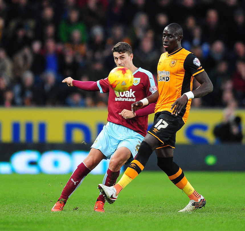 Burnley's Matthew Lowton vies for possession with Hull City's Mohamed Diame<br /> <br /> Photographer Chris Vaughan/CameraSport<br /> <br /> Football - The Football League Sky Bet Championship - Hull City v Burnley - Saturday 26th December 2015 - Kingston Communications Stadium - Hull<br /> <br /> &copy; CameraSport - 43 Linden Ave. Countesthorpe. Leicester. England. LE8 5PG - Tel: +44 (0) 116 277 4147 - admin@camerasport.com - www.camerasport.com