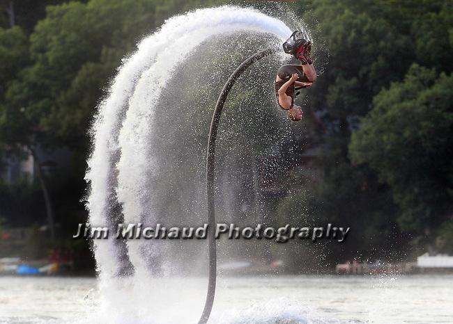 Ryan Luginbuhl , who operates New England Flyboard of Vernon, tries out his newest unit, with partner Tory Lussier, not seen, both of Vernon, who was driving the water ski that powers it, as Luginbuhl goes through some dives,  Tuesday, August 18, 2015, at Coventry Lake in Coventry. (Jim Michaud / Journal Inquirer)