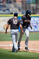 Jupiter Hammerheads left fielder Boo Vazquez (23) is congratulated by manager Kevin Randel (10) as he rounds third base after hitting a sixth inning home run during a game against the Clearwater Threshers on April 11, 2018 at Spectrum Field in Clearwater, Florida.  Jupiter defeated Clearwater 6-4.  (Mike Janes/Four Seam Images)