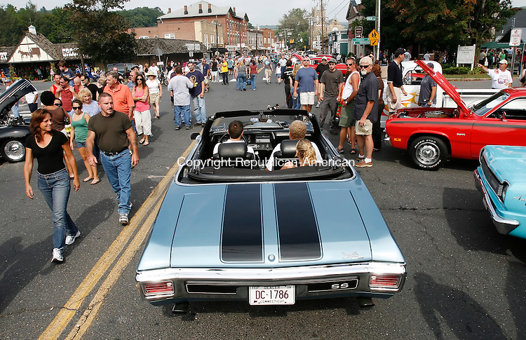 THOMASTON, CT, 09/14/08- 091408BZ19- A 1970 Chevelle parts the crowd while driving through the Thomaston Police Explorers 17th annual  Summer Cruz, in memory of its founder, the late Terry W. Hawley, who was a local police officer.<br /> Jamison C. Bazinet Republican-American
