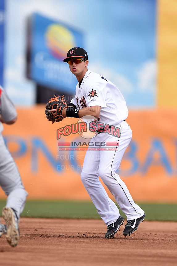 Frederick Keys shortstop Adrian Marin (3) attempts to turn a double play during a game against the Carolina Mudcats on April 26, 2014 at Harry Grove Stadium in Frederick, Maryland.  Carolina defeated Frederick 4-2.  (Mike Janes/Four Seam Images)