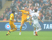 Preston North End's Ben Davies vies for possession with Swansea City's Oliver McBurnie<br /> <br /> Photographer Kevin Barnes/CameraSport<br /> <br /> The EFL Sky Bet Championship - Swansea City v Preston North End - Saturday August 11th 2018 - Liberty Stadium - Swansea<br /> <br /> World Copyright &copy; 2018 CameraSport. All rights reserved. 43 Linden Ave. Countesthorpe. Leicester. England. LE8 5PG - Tel: +44 (0) 116 277 4147 - admin@camerasport.com - www.camerasport.com
