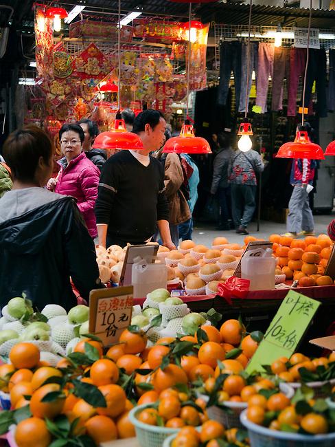 Hong Kong urban scene fruit seller on market street