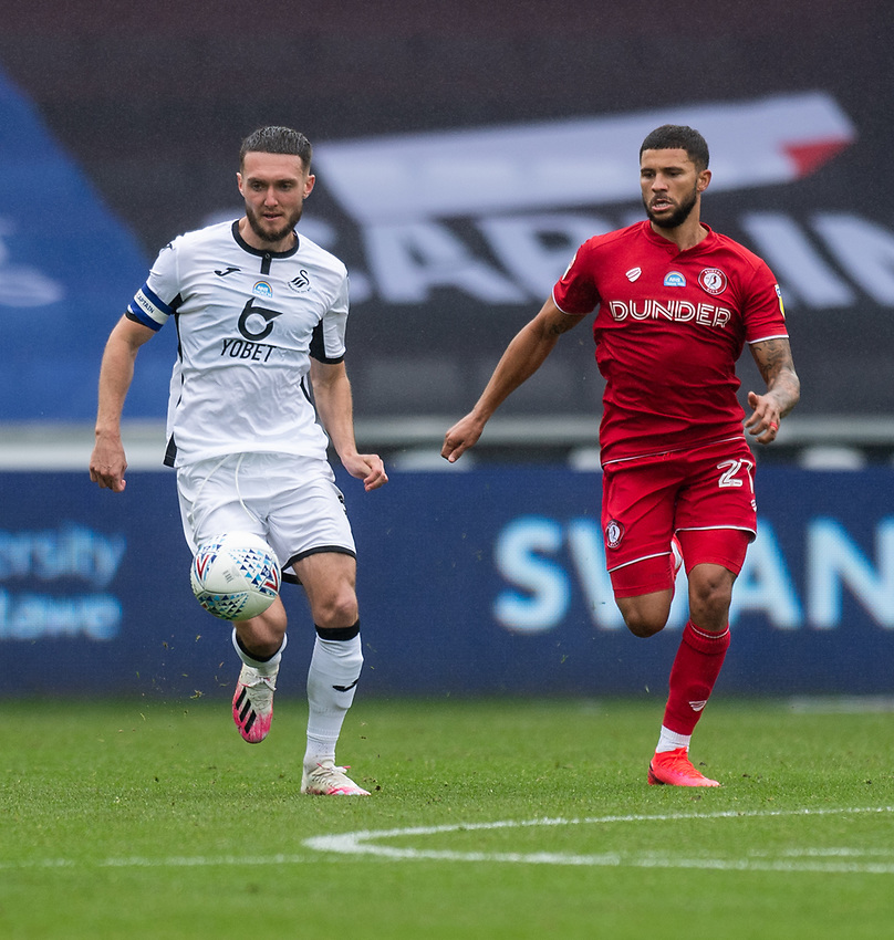 Swansea City's Matt Grimes (left) under pressure from Bristol City's Nakhi Wells (right) <br /> <br /> Photographer David Horton/CameraSport<br /> <br /> The EFL Sky Bet Championship - Swansea City v Bristol City- Saturday 18th July 2020 - Liberty Stadium - Swansea<br /> <br /> World Copyright © 2019 CameraSport. All rights reserved. 43 Linden Ave. Countesthorpe. Leicester. England. LE8 5PG - Tel: +44 (0) 116 277 4147 - admin@camerasport.com - www.camerasport.com