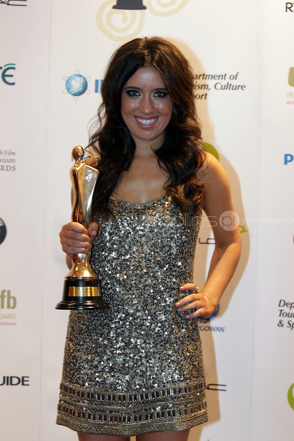 12/2/11 Lottie Ryan, recieves  the award for best factual programme for Operation Transformation on behalf of her late father Gerry Ryan at the 8th Irish Film and Television Awards at the Convention centre in Dublin. Picture:Arthur Carron/Collins