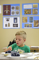 NWA Democrat-Gazette/BEN GOFF @NWABENGOFF<br /> Cason Stoufflet, 6, of Cave Springs paints the gargoyle he made out of modeling clay Friday, July 14, 2017, during ArtCamp: Medieval Adventure at First Presbyterian Church in Rogers. During the five-day camp for rising 1st through 7th graders, students made various art projects inspired by such things as illuminated manuscripts, stained glass windows, relief carving, tapestries and architecture.