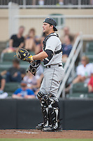 West Virginia Power catcher Taylor Gushue (17) on defense against the Kannapolis Intimidators at Intimidators Stadium on July 3, 2015 in Kannapolis, North Carolina.  The Intimidators defeated the Power 3-0 in a game called in the bottom of the 7th inning due to rain.  (Brian Westerholt/Four Seam Images)