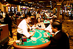 Blackjack table in Las Vegas, Nevada, Caesars Palace and Casino, gaming, gambling, chips, blackjack, betting croupier, blackjack players, model released, blackjack table, cards, NV, Las Vegas, Photo nv244-17150..Copyright: Lee Foster, www.fostertravel.com, 510-549-2202,lee@fostertravel.com