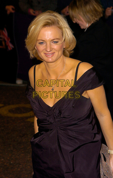 ALICE BEER.British Comedy Awards 2007, London Studios, South Bank, London, England. .December 5th 2007.half length black dress off the shoulder straps .CAP/CAN.©Can Nguyen/Capital Pictures