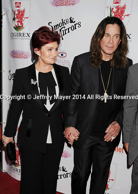 BEVERLY HILLS, CA- SEPTEMBER 13: TV personalities Ozzy Osbourne (R) and Sharon Osbourne attend the Brent Shapiro Foundation for Alcohol and Drug Awareness' annual 'Summer Spectacular Under The Stars' at a private residence on September 13, 2014 in Beverly Hills, California.