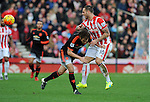 Marko Arnautovic of Stoke City is challenged by Daley Blind of Manchester United<br /> - Barclays Premier League - Stoke City vs Manchester United - Britannia Stadium - Stoke on Trent - England - 26th December 2015 - Pic Robin Parker/Sportimage