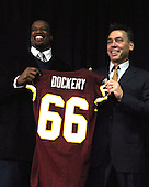 Ashburn, VA - March 3, 2009 -- Washington Redskins head coach Jim Zorn, left, and newly re-signed guard Derrick Dockery hold up a jersey with Hall's number on it after speaking to reporters about Dockery's recent signing of a 5 year, $27 million contract that features a $8.5 million guarantee and calls for $11.5 million to be paid over the first 2 years. .Credit: Ron Sachs / CNP