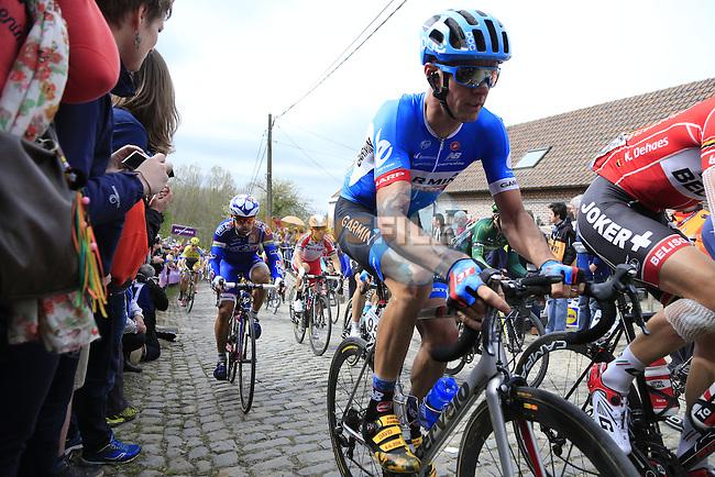 The peleton, including David Millar (GBR) Garmin Sharp, climb the Molenberg during the 2014 Tour of Flanders, Belgium.<br /> Picture: Eoin Clarke www.newsfile.ie