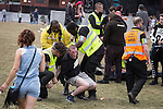 © Joel Goodman - 07973 332324 . 07/06/2015 . Manchester , UK . Security detain and remove two men at The Parklife 2015 music festival in Heaton Park , Manchester . Photo credit : Joel Goodman