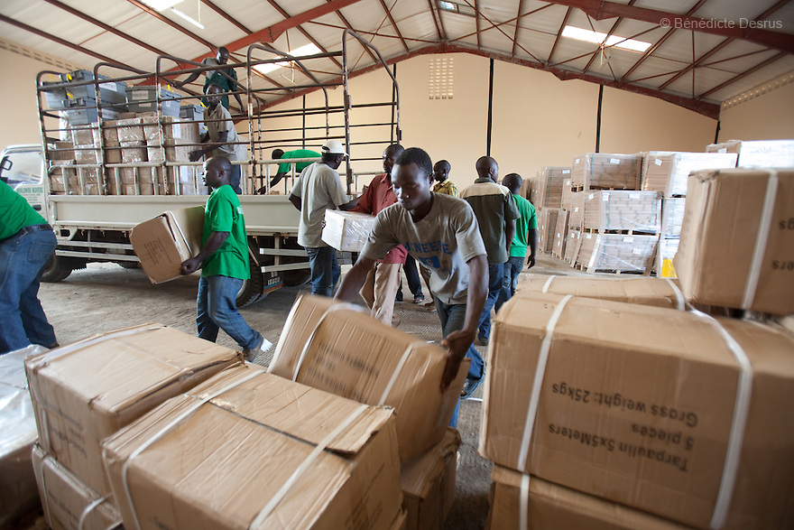 wednesday 22 december 2010 - Juba, South Sudan - Southern Sudanese men store referendum polling kits inside the UNIRED Warehouse in Juba. More than 7.3 million ballots have arrived in Southern Sudan for an independence referendum that is likely to create the world's newest country. U.N. official Denis Kadima said a chartered plane delivered the ballots Wednesday from England, where they were printed. Photo credit: Benedicte Desrus