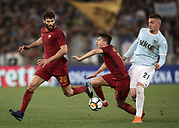 Calcio, Serie A: S.S. Lazio - A.S. Roma, stadio Olimpico, Roma, 15 aprile 2018. <br /> Roma's Cengiz Under (c) in action with Roma's Federico Fazio (l) and Lazio's Sergej Milinkovic (r) during the Italian Serie A football match between S.S. Lazio and A.S. Roma at Rome's Olympic stadium, Rome on April 15, 2018.<br /> UPDATE IMAGES PRESS/Isabella Bonotto