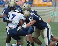 Pitt linebackers Greg Williams (38) and Joe Trebitz (53) bring down Maine running back Roosevelt Boone.. The Pitt Panthers beat the Maine Black Bears 35-29 at Heinz Field, Pittsburgh, PA on September 10, 2011.
