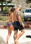 26 NOVEMBER 2015 SYDNEY AUSTRALIA<br /> <br /> EXCLUSIVE PICTURES<br /> <br /> Michelle Bridges pictured with Steve Willis at Tamarama Beach enjoying a lazy morning sun baking and having a swim. <br /> <br /> *No internet without clearance*.<br /> MUST CALL PRIOR TO USE +61 2 9211-1088. Matrix Media Group.Note: All editorial images subject to the following: For editorial use only. Additional clearance required for commercial, wireless, internet or promotional use.Images may not be altered or modified. Matrix Media Group makes no representations or warranties regarding names, trademarks or logos appearing in the images.