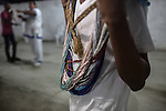 RIO DE JANEIRO, BRAZIL - JANUARY 24: Practitioners wear beads that correspond to the orixas they identify with. It is a symbolic representations of the orix&aacute;s. in Rio de Janeiro, Brazil, on Saturday, Jan. 23, 2015. Brazil's Afro-Brazilian religions which in recent years have come under increasing threats and prejudice, particularly from the growing number of evangelical churches. Candombl&eacute; originated in Salvador, Bahia at the beginning of the 19th century when enslaved Africans brought their beliefs with them. Umbanda and candombl&eacute; are Afro-Brazilian religions practiced in mostly Brazil. <br /> (Lianne Milton for the Washington Post)