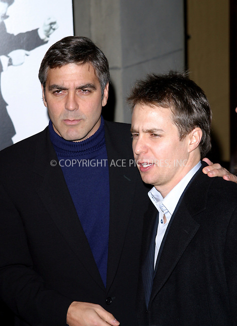 George Clooney and Sam Rockwell at the NY premiere of 'Confessions Of A Dangerous Mind' held at the Paris Theater. New York, December 19, 2002..Please byline: NY Photo Press. REF: M19 -- THIS REFERENCE CODE MUST APPEAR ON YOUR SALES REPORT, THANK YOU.....*PAY-PER-USE*      ....NY Photo Press:  ..phone (646) 267-6913;   ..e-mail: info@nyphotopress.com