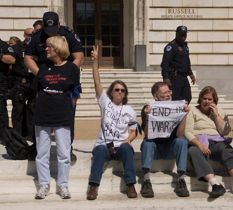 A protester with Declaration of Peace is arrested outside of the Russell Senate Office Building as the group staged non-violent actions to protest the war in Iraq around the Capitol on Tuesday, Sept. 26, 2005. The group wants the Senate to pass legislation that includes prompt troop withdrawal and a comprehensive peace plan in Iraq.