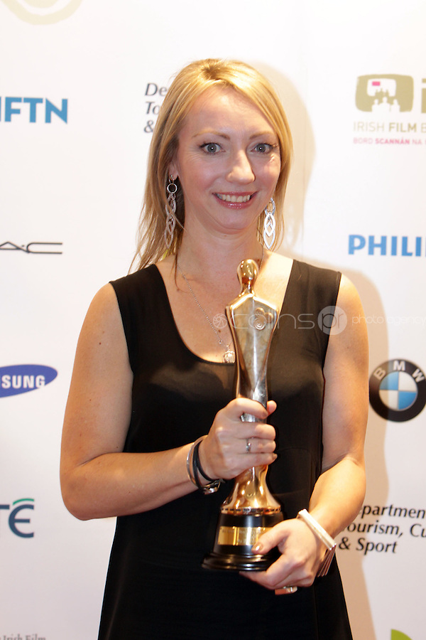 12/2/11 Juanita Wilson, winner of Best Script, Best Directorand Best Film for As If I'm Not There,  at the 8th Irish Film and Television Awards at the Convention centre in Dublin. Picture:Arthur Carron/Collins