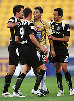 Phoenix captain Tim Brown (left) steps in as Shane Smeltz has words with Newcastle's Adam D'Apuzzo as Jeremy Christie (right) joins the party during the A-League match between Wellington Phoenix and Newcastle Jets at Westpac Stadium, Wellington, New Zealand on Sunday, 4 January 2009. Photo: Dave Lintott / lintottphoto.co.nz