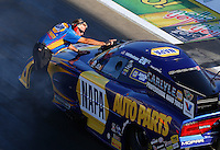 Aug 15, 2014; Brainerd, MN, USA; Crew chief, Rahn Tobler directs NHRA funny car driver Ron Capps as he stages during qualifying for the Lucas Oil Nationals at Brainerd International Raceway. Mandatory Credit: Mark J. Rebilas-