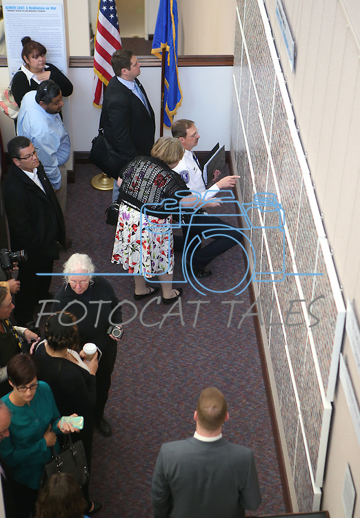 Approximately 50 people attend the opening ceremony of the Always Lost: A Meditation on War exhibit at the Legislative Building in Carson City, Nev., on Monday, April 6, 2015. <br /> Photo by Cathleen Allison/Nevada Photo Source