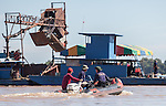 20 October 2013, Pakse, Laos:  Thai and Lao rescue and recovery teams head to a barge sifting the Sedon River for wreckage following a crash of a Lao Airlines plane into the river at Pakse, Laos. The aircraft crashed into the Mekong River tributary on approach to Pakse airport from Vientiane in severe weather killing all 44 passengers and 5 crew on board. Rescue workers are still dragging the fast flowing river for further remains and the main body of the plane.  Picture by Graham Crouch