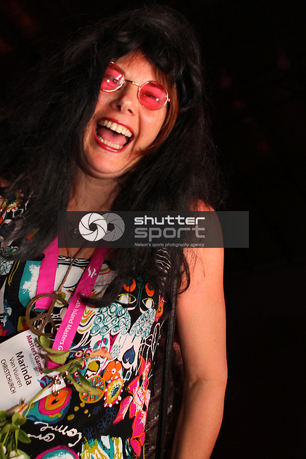 Marinda Van Vuuren from Christchurch gets into the swing at the Solid Gold Hard Days Night Beatles Party at McCashin's Brewery<br /> SI Masters Games, 22 October 2011, Nelson, New Zealand<br /> Photo: Marc Palmano/shuttersport.co.nz