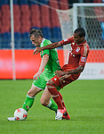 Luiz Gustavo of Bayern Munich and Ivica Olic of VfL Wolfsburg in action during a friendly match as part of the Audi Football Summit 2012 on July 26, 2012 at the Guangdong Olympic Sports Center in Guangzhou, China. Photo by Victor Fraile / The Power of Sport Images
