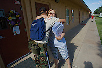 mr-cadets0530   159009- Arizona Project Challenge cadet  Michael Jensen hugs Sequoia Charter School teacher Becky Richardson. Jensen helps out in her classroom helping children learn to read.  Arizona Project Challenge provides a live-in military based education for high school drop outs.  Michael Jensen, of Gilbert, will be the first Arizona Project Challenge cadet to graduate with a high school diploma from Sequoia Choice Arizona Distance Learning in Mesa. (Pat Shannahan/ The Arizona Republic)