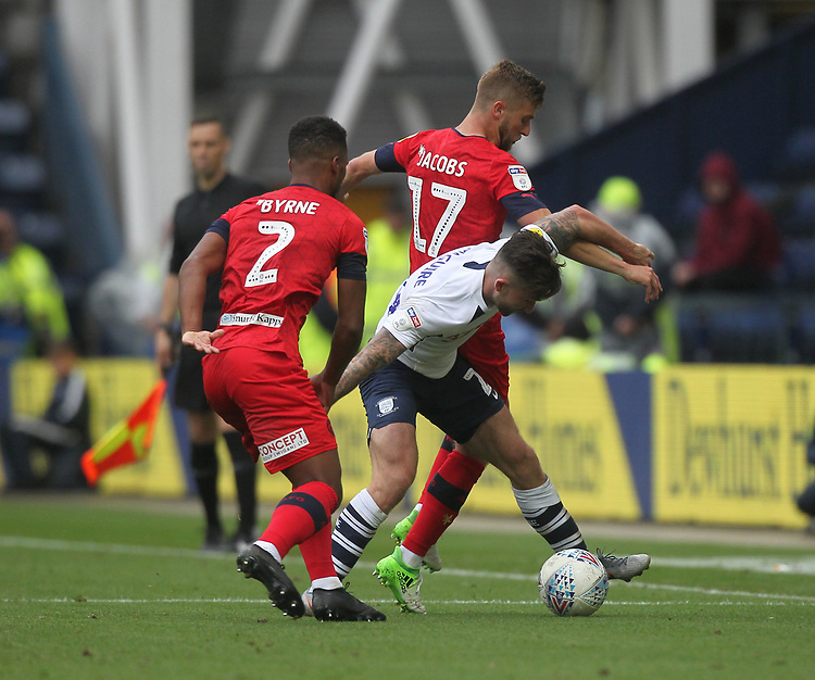 Preston North End's Sean Maguire battles with  Wigan Athletic's Nathan Byrne and Wigan Athletic's Michael Jacobs <br /> <br /> Photographer Mick Walker/CameraSport<br /> <br /> The EFL Sky Bet Championship - Preston North End v Wigan Athletic - Saturday 10th August 2019 - Deepdale Stadium - Preston<br /> <br /> World Copyright © 2019 CameraSport. All rights reserved. 43 Linden Ave. Countesthorpe. Leicester. England. LE8 5PG - Tel: +44 (0) 116 277 4147 - admin@camerasport.com - www.camerasport.com