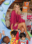 CALABASAS, CA - SEPTEMBER 14: Heidi Klum poses at the debut of her Truly Scrumptious Collection at Babies R Us on September 14, 2012 in Calabasas, California.