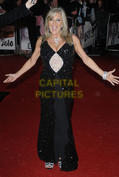 SAMANTHA FOX.Arrivals the Brit Awards 2010 held at Earls Court, London, England..February 16th 2010 .Brits full length Sam black dress slit split sequined sequins beads beaded white sandals sleeveless bracelet hands arms mouth open maxi.CAP/CAN.©Can Nguyen/Capital Pictures.